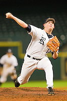 Rice Owls relief pitcher John Simms #13 in action against the Texas Longhorns at Minute Maid Park on March 2, 2012 in Houston, Texas.  The Longhorns defeated the Owls 11-8.  (Brian Westerholt/Four Seam Images)