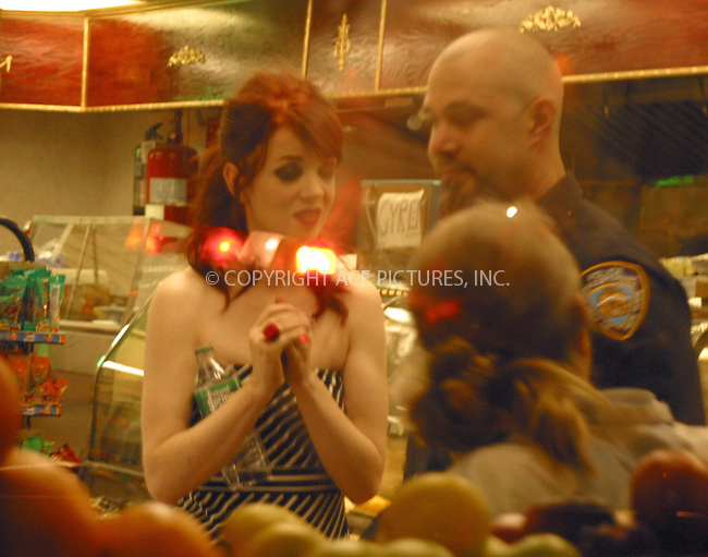WWW.ACEPIXS.COM . . . . .***EXCLUSIVE!!! FEE MUST BE NEGOTIATED BEFORE USE!!!***....NEW YORK, APRIL 20, 2005....Shirley Manson is seen on the set of the new Garbage video being shot in midtown Manhattan's west side. Shirley Manson takes the down time to eat a burger, grab a cardigan from her limo and watch her body double from the back of a van. As day turns to night on the set, we see her bodyguard, dressed as a New York Police Officer, escort her to a local deli for some snacks.....Please byline: PAUL CUNNINGHAM - ACE PICTURES.... *** ***..Ace Pictures, Inc:  ..Craig Ashby (212) 243-8787..e-mail: picturedesk@acepixs.com..web: http://www.acepixs.com