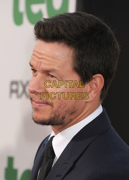 "Mark Wahlberg.arriving at the World Premiere of ""Ted"" at Grauman's Chinese Theatre in Hollywood, California, USA, .June 21st, 2012. .portrait headshot beard facial hair  suit tie   navy blue white shirt black side profile .CAP/ROT/TM.©TM/Roth Stock/Capital Pictures"