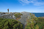 Hiker Enjoying View of the Baltic Sea from Rocky Promontory on the Island of Kökar