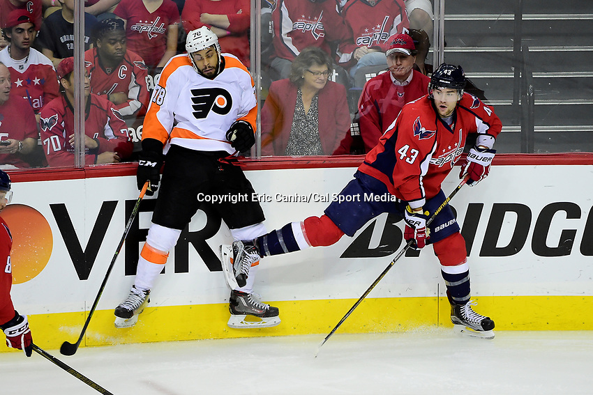 Friday, April 22, 2016: Philadelphia Flyers right wing Pierre-Edouard Bellemare (78) hits the boards after getting tangled with Washington Capitals right wing Tom Wilson (43) during game 5 of the first round of the National Hockey League Eastern Conference playoffs  between the Philadelphia Flyers and the Washington Capitals held at the Verizon Center in Washington, DC. The Flyers defeat the Capitals 2-0. Eric Canha/CSM