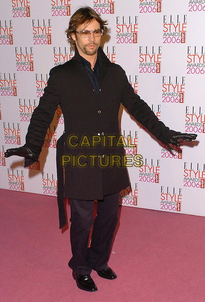 JAY KAY.Elle Style Awards 2006 - Arrivals,.Atlantis Gallery, Old truman Brewery, Brick Lane, London, England,.February 20th 2006..full length black coat gloves sunglasses funny pose arms.Ref: CAN.www.capitalpictures.com.sales@capitalpictures.com.©Capital Pictures