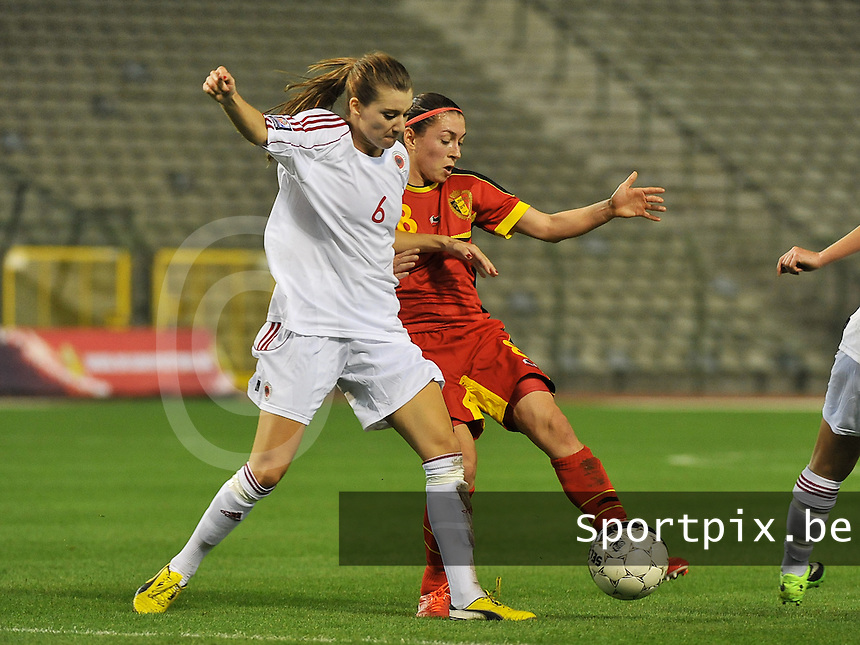 20130921 - BRUSSELS , BELGIUM : Belgian Audrey Demoustier pictured  with Albanian Memedov Dafina (left) during the female soccer match between Belgium and Albania , on the first matchday in group 5 of the UEFA qualifying round to the FIFA Women World Cup in Canada 2015 at the Koning Boudewijn Stadion , Brussels . Saturday 21th September 2013. PHOTO DAVID CATRY