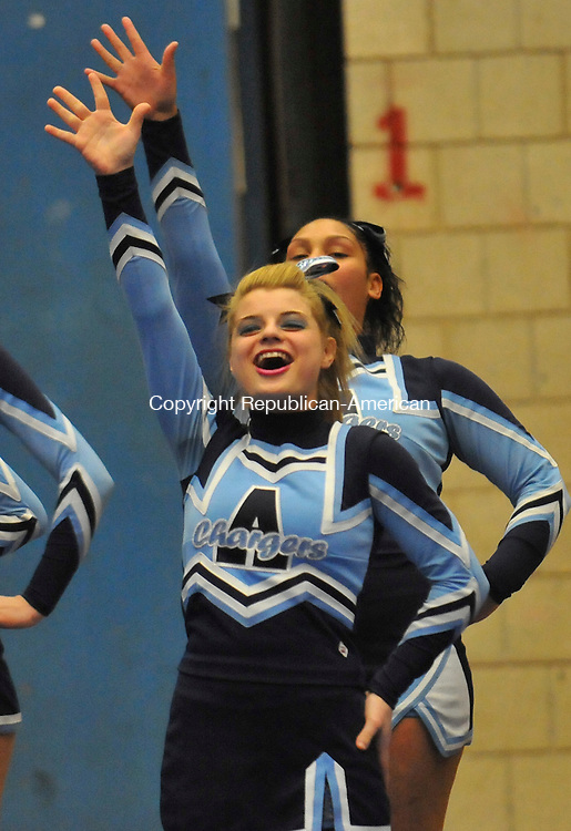 WATERBURY, CT-01 MARCH 2009-030110IP05- Lindsie Nihill (front) and Trisha Denby of the Ansonia High School cheerleading team compete with their teammates during the NVL cheerleading championships at Crosby High School in Waterbury on Monday. <br /> Irena Pastorello Republican-American