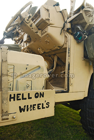 "Inscription ""Hell on Wheels"" found on an army Land Rover 110 Pink Panther.  Exhibited at Dunsfold Collection of Land Rovers 2006 open day, Dunsfold, Surrey, England, UK.  --- No releases available. Automotive trademarks are the property of the trademark holder, authorization may be needed for some uses."