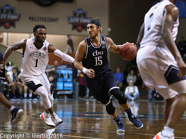 SIOUX FALLS, SD: MARCH 20:  Jordan Heading #15 of Cal Baptist gets pressure from Daniel Carr #1 of Queens during their game at the 2018 Division II Men's Elite 8 Basketball Championship at the Sanford Pentagon in Sioux Falls, S.D. (Photo by Dick Carlson/Inertia)