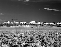 F00114M.tiff  Miles of power lines with Trout Creek Mountains, near Fields Oregon.
