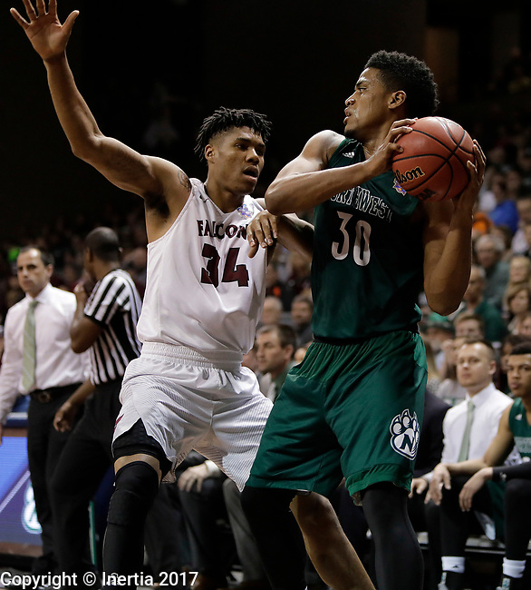 SIOUX FALLS, SD: MARCH 25:  D'Vante Mosby #30 of Northwest Missouri State shields the ball rom Fairmont State defender Troy Cantrell #34 during the Men's Division II Basketball Championship game on March 25, 2017 at the Denny Sanford Premier Center in Sioux Falls, SD. (Photo by Dick Carlson/Inertia)