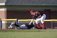 Batavia Muckdogs first baseman Ben Fisher (36) lays the tag on Bligh Madris (17) diving back safely to first base on a pickoff attempt during a game against the West Virginia Black Bears on June 26, 2017 at Dwyer Stadium in Batavia, New York.  Batavia defeated West Virginia 1-0 in ten innings.  (Mike Janes/Four Seam Images)