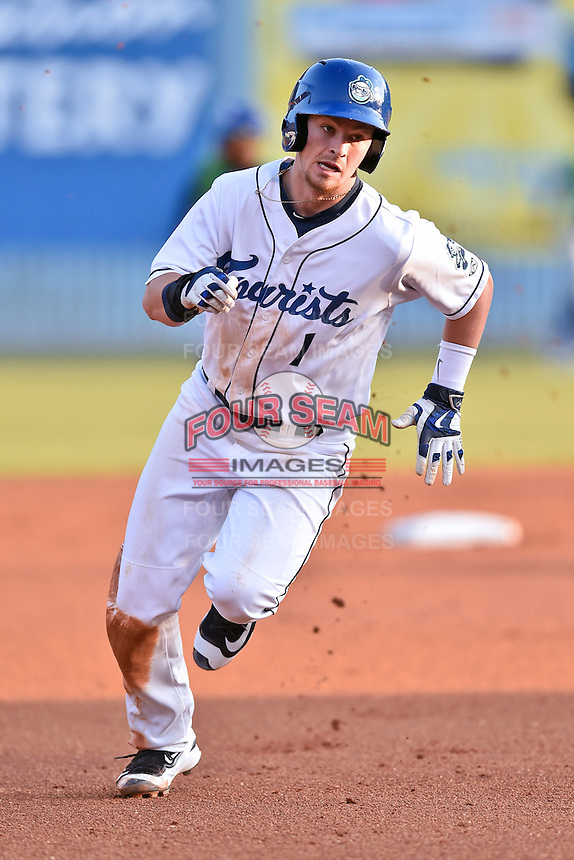 Asheville Tourists designated hitter Brendan Rodgers (1) runs to third during a game against the Lexington Legends at McCormick Field on April 20, 2016 in Asheville, North Carolina. The Tourists defeated the Legends 10-0. (Tony Farlow/Four Seam Images)