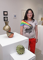 Surface to Structure origami exhibition at Cooper Union, New York. Gallery view. Uyen Nguyen, curator of the exhibit and origami designer.