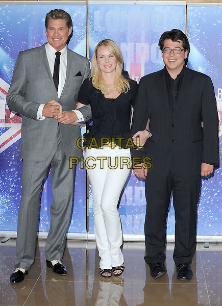 DAVID HASSELHOFF, AMANDA HOLDEN & MICHAEL McINTYRE.The Britain's Got Talent new series launch photocall, Mayfair Hotel, London, England..April 13th, 2011.BGT full length grey gray suit white trousers black suit top glasses two tone shoes holding hands.CAP/BEL.©Tom Belcher/Capital Pictures.