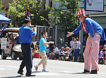 "A young onlooker, is selected for an individual greeting, by ""Uncle Sam"" depicted by, David Cardall, 70, of Saugerties, as he walked the route of the 2013 Independence Day Parade, in Saugerties, NY on Thursday, July 4, 2013. Photo by Jim Peppler. Copyright Jim Peppler 2013 all rights reserved."