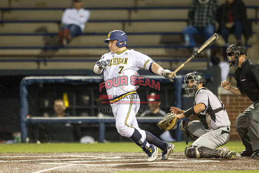 Michigan Wolverines catcher Harrison Wenson (7) follows through on his swing against the Oakland Golden Grizzlies on May 17, 2016 at Ray Fisher Stadium in Ann Arbor, Michigan. Oakland defeated Michigan 6-5 in 10 innings. (Andrew Woolley/Four Seam Images)