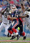 26 November 2006: Buffalo Bills quarterback J.P. Losman (7) narrowly avoids a sack by defensive ends Bobby McCray (93) and Paul Spicer (95) of the Jacksonville Jaguars at Ralph Wilson Stadium in Orchard Park, NY. The Bills defeated the Jaguars 27-24. Mandatory Photo Credit: Ed Wolfstein Photo<br />
