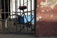 Old bicycle parked against a wall, Trinidad, Sancti Spiritus, Cuba.
