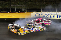 Oct. 15, 2009; Concord, NC, USA; NASCAR Nationwide Series driver Erik Darnell (6) crashes with Matt Kenseth (16) and Jason Leffler (38) goes high to avoid during the Dollar General 300 at Lowes Motor Speedway. Mandatory Credit: Mark J. Rebilas-