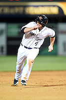 Lakeland Flying Tigers outfielder Chad Wright (4) runs the bases during a game against the Brevard County Manatees on April 10, 2014 at Joker Marchant Stadium in Lakeland, Florida.  Lakeland defeated Brevard County 6-5.  (Mike Janes/Four Seam Images)