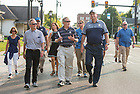August 13, 2017; University of Notre Dame President Rev. John I. Jenkins, C.S.C., (left) Jack Brennan, chairman of the University of Notre Dame's Board of Trustees and Governor Eric Holcomb join the pilgrims as they walk the first two miles of the ND Trail through downtown Vincennes, Indiana. <br />