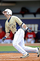 4 March 2012:  FIU infielder Mike Martinez (40) bats as the FIU Golden Panthers defeated the Brown University Bears, 8-3, at University Park Stadium in Miami, Florida.