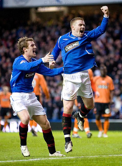 John Fleck celebrates his first Rangers goal with team-mate Steven Davis