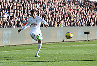 SWANSEA, WALES - FEBRUARY 21: Kyle Naughton of Swansea takes a cross during the Barclays Premier League match between Swansea City and Manchester United at Liberty Stadium on February 21, 2015 in Swansea, Wales.