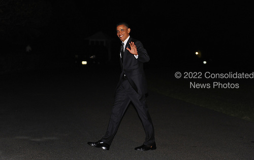 United States President Barack Obama walks on the South Lawn of the White House as he returns from the Los Cabos G-20 Summit,  June 20, 2012 in Washington, DC. .Credit: Olivier Douliery / Pool via CNP