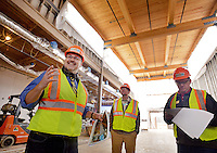 STAFF PHOTO BEN GOFF  @NWABenGoff -- 12/12/14 Sam Dean, left, Executive Director of the Amazeum, leads a tour of the children's museum under construction in Bentonville for members of the Bentonville City Council on Friday Dec. 12, 2014.