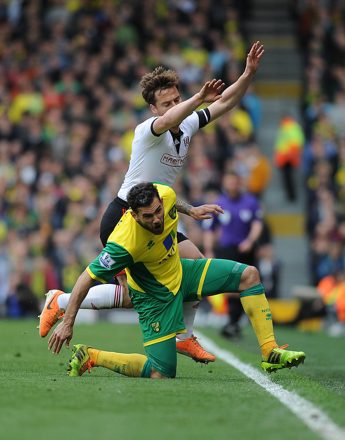 Fulham's Scott Parker is tackled by Norwich City's Robert Snodgrass<br /> <br /> Photo by Ashley Western/CameraSport<br /> <br /> Football - Barclays Premiership - Fulham v Norwich City - Saturday 12th April 2014 - Craven Cottage - London<br /> <br /> &copy; CameraSport - 43 Linden Ave. Countesthorpe. Leicester. England. LE8 5PG - Tel: +44 (0) 116 277 4147 - admin@camerasport.com - www.camerasport.com