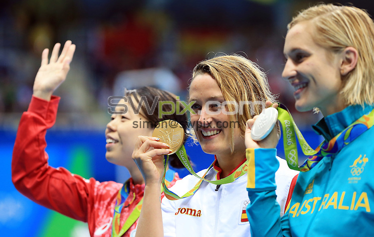 RIO DE JANEIRO, BRAZIL - AUGUST 10:  Natsumi Hoshi (L) of Japan wins Bronze, Mireia Belmonte Garcia (C) of Spain wins Gold and Madeline Groves (R) of Australia wins Silver in the Women's 200m Butterfly Final on Day 5 of the Rio 2016 Olympic Games at the Olympic Aquatics Stadium on August 10, 2016 in Rio de Janerio, Brazil.  (Photo by Vaughn Ridley/SWpix.com)