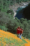 Couple hiking through a meadow of wildflowers in the American River Canyon