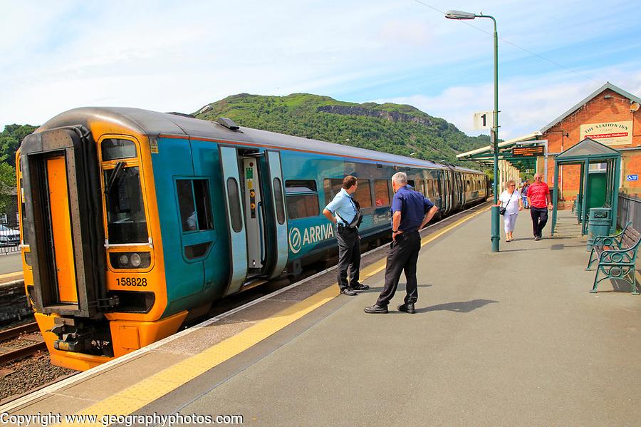 Arrive train at platform Portmadog, Gwynedd, north west Wales, UK