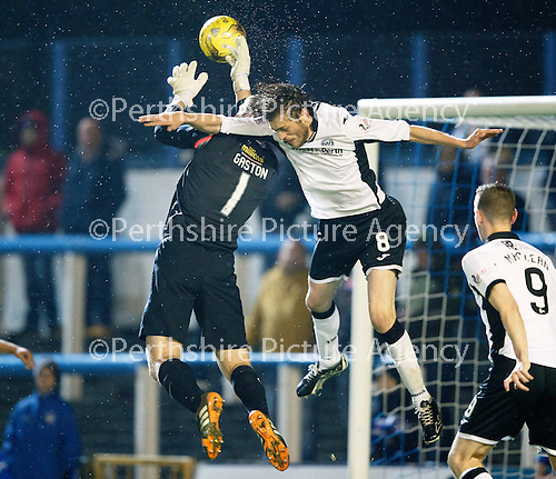 Greenock Morton v St Johnstone...27.10.15  League Cup Quarter Final, Cappielow...<br /> Murray Davidson challenges keeper Derek Gaston<br /> Picture by Graeme Hart.<br /> Copyright Perthshire Picture Agency<br /> Tel: 01738 623350  Mobile: 07990 594431