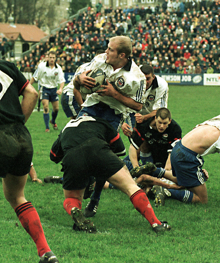Photo Richard Lane. .Bath v Saracens. 19/12/98..Russell Earnshaw is tackled by Kyran Bracken.