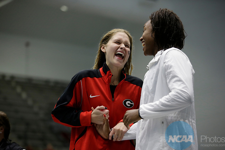INDIANAPOLIS, IN - MARCH 18: Simone Manuel swimming for Stanford, right, and Olivia Smoliga, swimming for Georgia share a laugh after the 100-meter freestyle during the Division I Women's Swimming & Diving Championships held at the Indiana University Natatorium on March 18, 2017 in Indianapolis, Indiana. (Photo by A.J. Mast/NCAA Photos via Getty Images)