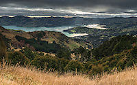 Moody skies over Akaroa township and harbour, Banks Peninsula, Canterbury, South Island, New Zealand