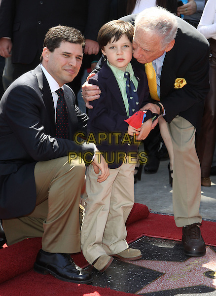MAX BROOKS, his son Henry & MEL BROOKS.Mel Brooks is honoured with the 2406th star on the Hollywood Walk of Fame held On Hollywood Blvd., Hollywood, California, USA, 23 April 2010..full length navy blue jacket suit tie  suit son family yellow grandson grandfather dad father  child bending kneeling down .CAP/ADM/KB.©Kevan Brooks/Admedia/Capital Pictures