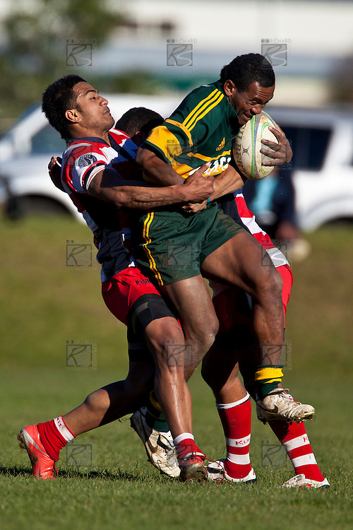 Reynold Lee-Lo struggles to hold onto the hard running David Raikuna. Counties Manukau Premier Club Rugby semi final game between Pukekohe and Karaka, played at Colin Lawrie Fields Pukekohe on Saturday July 10th 2010.Pukekohe won 44 - 20 and will meet Waiuku in next weeks final at Growers Stadium.