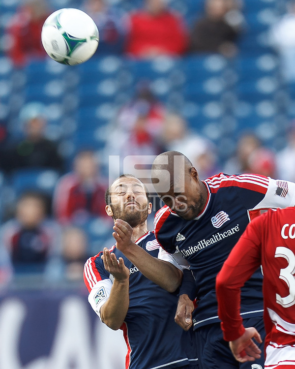 New England Revolution defender A.J. Soares (5) and New England Revolution defender Jose Goncalves (23) heads the ball. .  In a Major League Soccer (MLS) match, FC Dallas (red) defeated the New England Revolution (blue), 1-0, at Gillette Stadium on March 30, 2013.