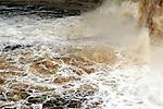 The boil area below the Upper Tahquamenon Falls in Upper Michigan.  Brown water tanic