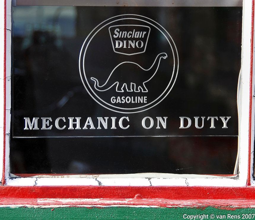 Window sign form 1950's era gas station announcing that a mechanic was available.