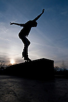 A youngster runs his skateboard along a rail edge as he and a few friends  enjoy themselves at the Westerville, OH, skate park  the day after Christmas using the gifts they received on Christmas day.