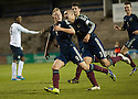 Scotland's Calvin Miller celebrates after he scores their first goal.