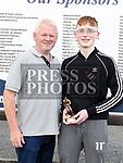 Ardee UTD U-15 player of the year Nicholas Brennan with coach Kieran McEvoy. Photo:Colin Bell/pressphotos.ie