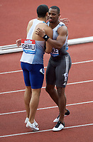 Yohan Blake (Jamaica) with Adam Gemili (Great Britain) after he wins the men's 100m final during the IAAF Diamond League Athletics Müller Grand Prix Birmingham at Alexander Stadium, Walsall Road, Birmingham on 18 August 2019. Photo by Alan  Stanford.