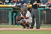 Guillermo Quiroz (41) of the Fresno Grizzlies on defense against the Salt Lake Bees at Smith's Ballpark on May 25, 2014 in Salt Lake City, Utah.  (Stephen Smith/Four Seam Images)