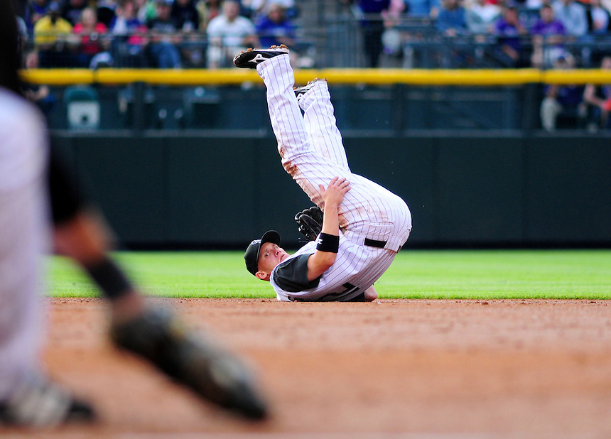 May 30, 2009: Rockies 2nd baseman Clint Barmes watches to see if the runner is out after making a defensive play during a game between the San Diego Padres and the Colorado Rockies at Coors Field in Denver, Colorado. The Rockies beat the Padres 8-7.