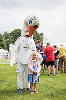 Pictured: Mascot, Cyril the swan Monday 20 July 2015<br /> Re: Swansea City FC event at the Royal Welsh Show in Builth, Wells, mid Wales.