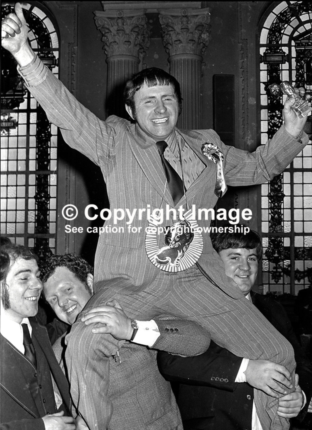 A jubilant Ulster Unionist candidate John Carson after winning the North Belfast seat in the 1974 UK General Election is shouldered after the count in Belfast City Hall by supporters. 197403010083b..Copyright Image from Victor Patterson, 54 Dorchester Park, Belfast, UK, BT9 6RJ..Tel: +44 28 9066 1296.Mob: +44 7802 353836.Voicemail +44 20 8816 7153.Skype: victorpattersonbelfast.Email: victorpatterson@me.com.Email: victorpatterson@ireland.com (back-up)..IMPORTANT: If you wish to use this image or any other of my images please go to www.victorpatterson.com and click on the Terms & Conditions. Then contact me by email or phone with the reference number(s) of the image(s) concerned.