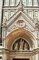 A detail crop of the lunette, pediment and tondo and the 14th c. sculptures. Note the file size. The lunette sculpture set is a ?Virgin and Child with Two Angels? by Lorenzo di Giovanni d'Ambroglio. In the tondo are two figures wrapping Christ in his shroud, supported by two angels in the lower spaces. The Gothic-Renaissance Duomo of Florence,  Basilica of Saint Mary of the Flower; Firenza ( Basilica di Santa Maria del Fiore ).  Built between 1293 & 1436. Italy